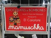 Фото из тура в Патагонию в 2012 году. Matreshka+Babushka=Mamushka! Реклама на тележках в аэропорту Эль Калафате.